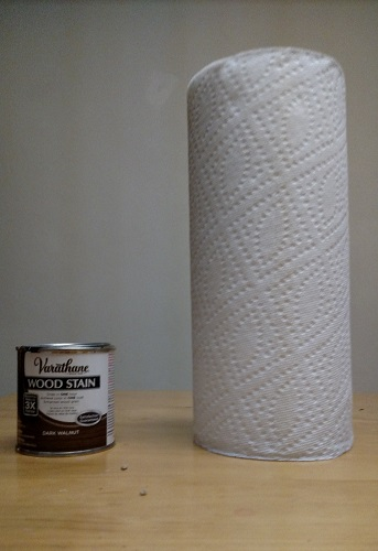 a jar of wood stain and a roll of paper towels